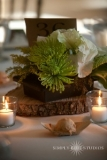 Rustic Centerpiece - Tree slices, Kale and simple flowers create a great rustic centerpiece